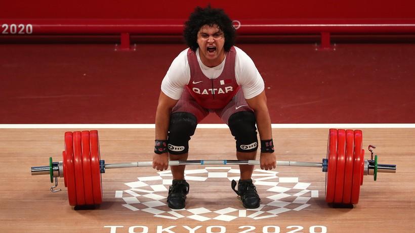 Tokio 2020: Katarczyk triumfował w kat. 96 kg, Bartłomiej Adamus siódmy w podnoszeniu ciężarów